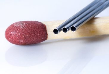 Tiny tubes photographed with a match for scale
