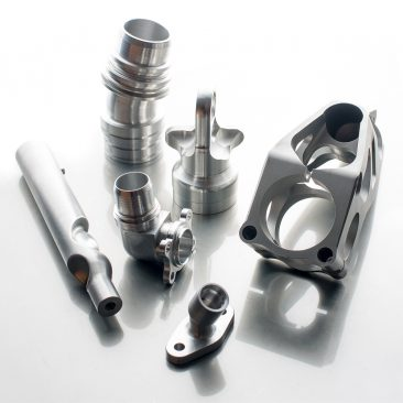 Machined metal parts photographed on shiny surface