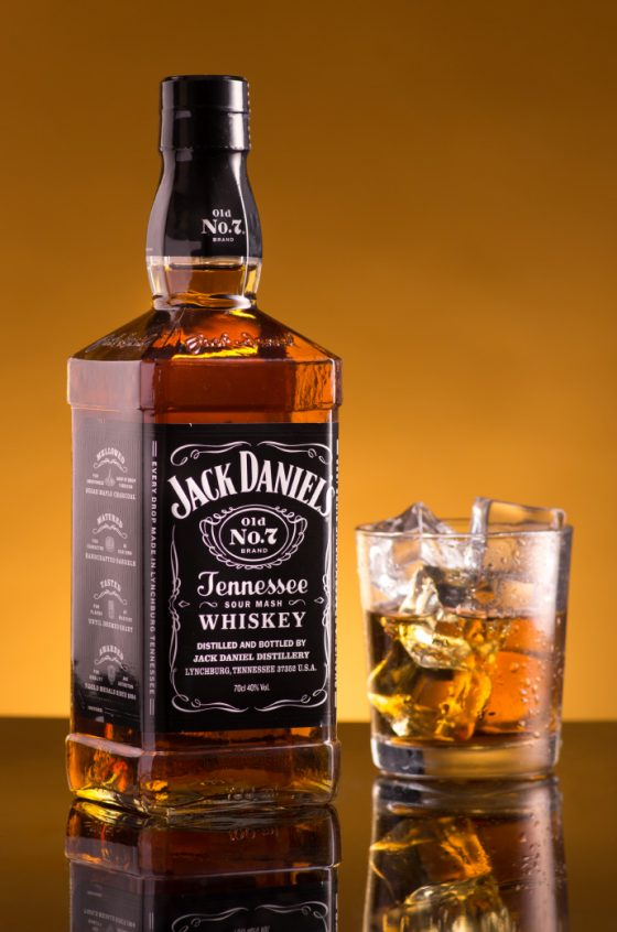 Jack Daniels bottle and tumbler with ice