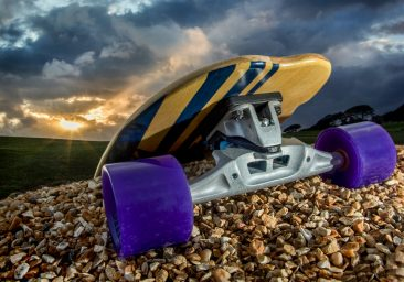 Skate board - longboard photographed on gravel