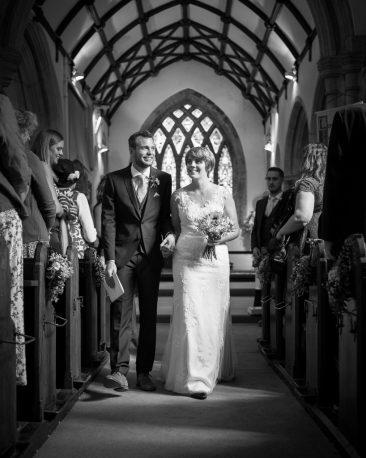 Wedding couple walk down the isle