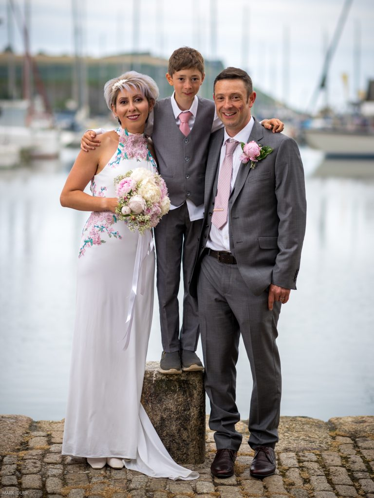 Bride and groom on harbour side