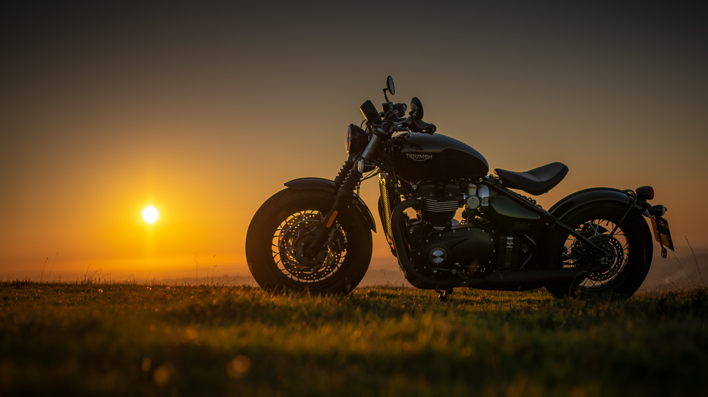 Triumph Bobber Motorcycle against sunset