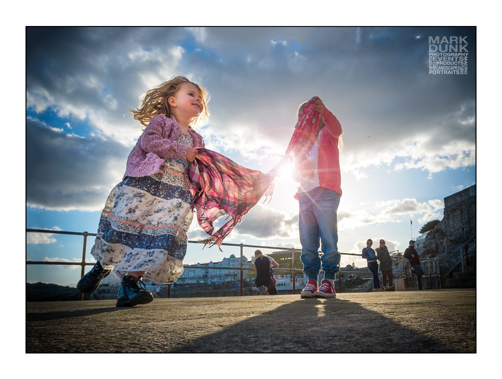 Children dancing on Plymouth waterfront