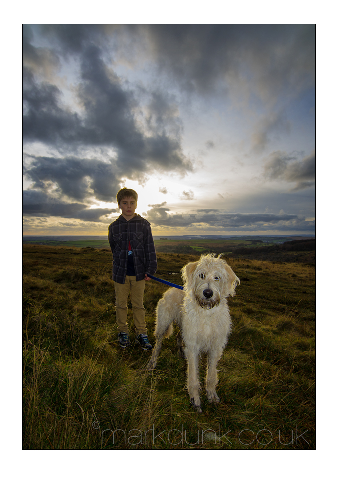 Boy and dog photographed for family pet portrait