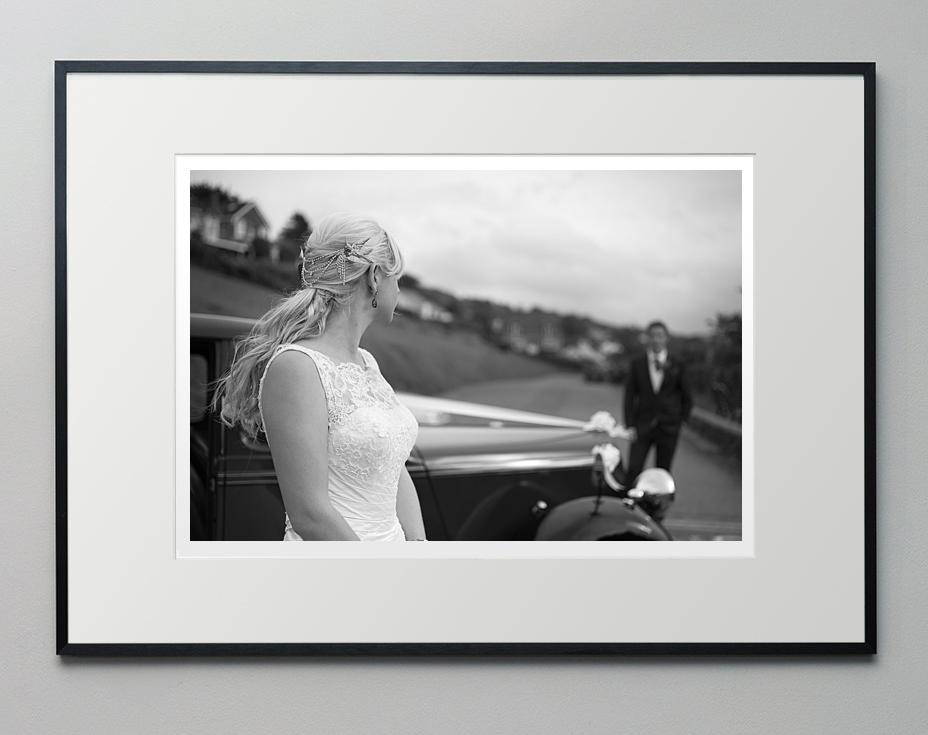 Framed wedding photo on a wall